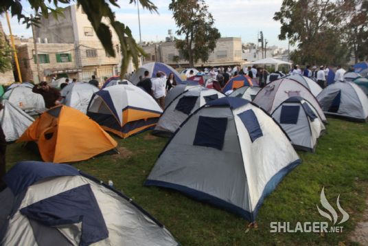Tents set up by the thousands who descend upon Hebron for Parshat Hayei Sarah- for them, a camping trip, for the Palestinians in Hebron, lockdown.