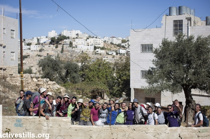 Young settlers singing hateful songs outside of Palestinian houses in Tel Rumeida, Hebron