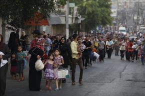Fleeing in Gaza. Photo: Iyad al Baba/Oxfam