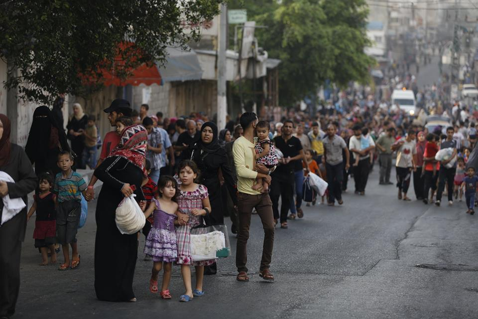 Fleeing in Gaza. Photo: Iyad al Baba/Oxfam