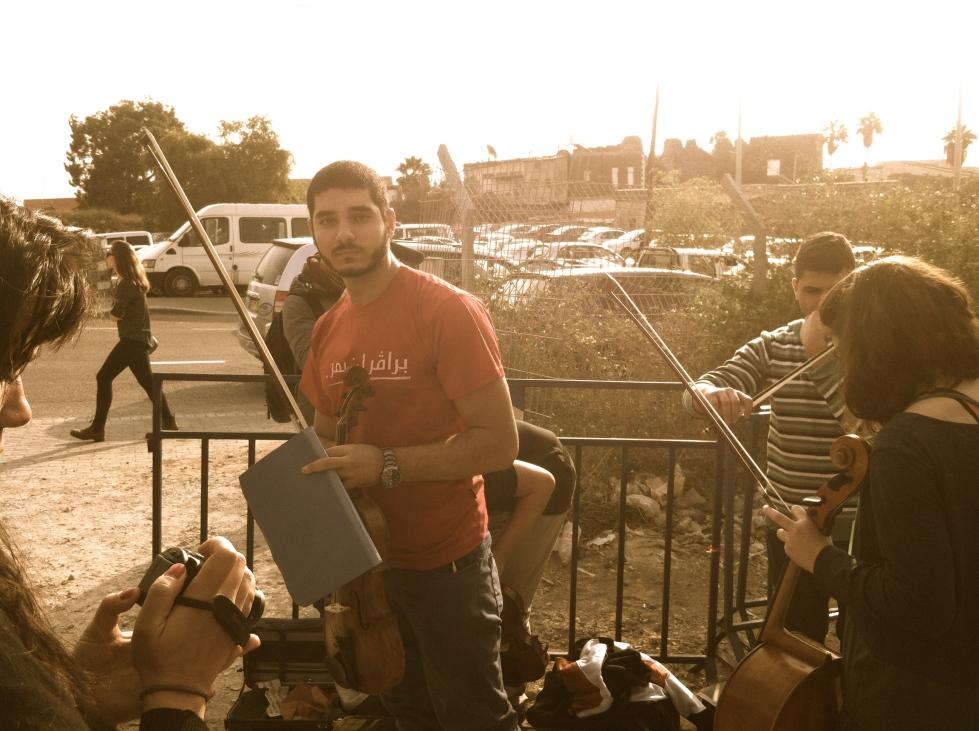 Refusenik Omar Saad preparing to go to jail, choosing his viola over a rifle.