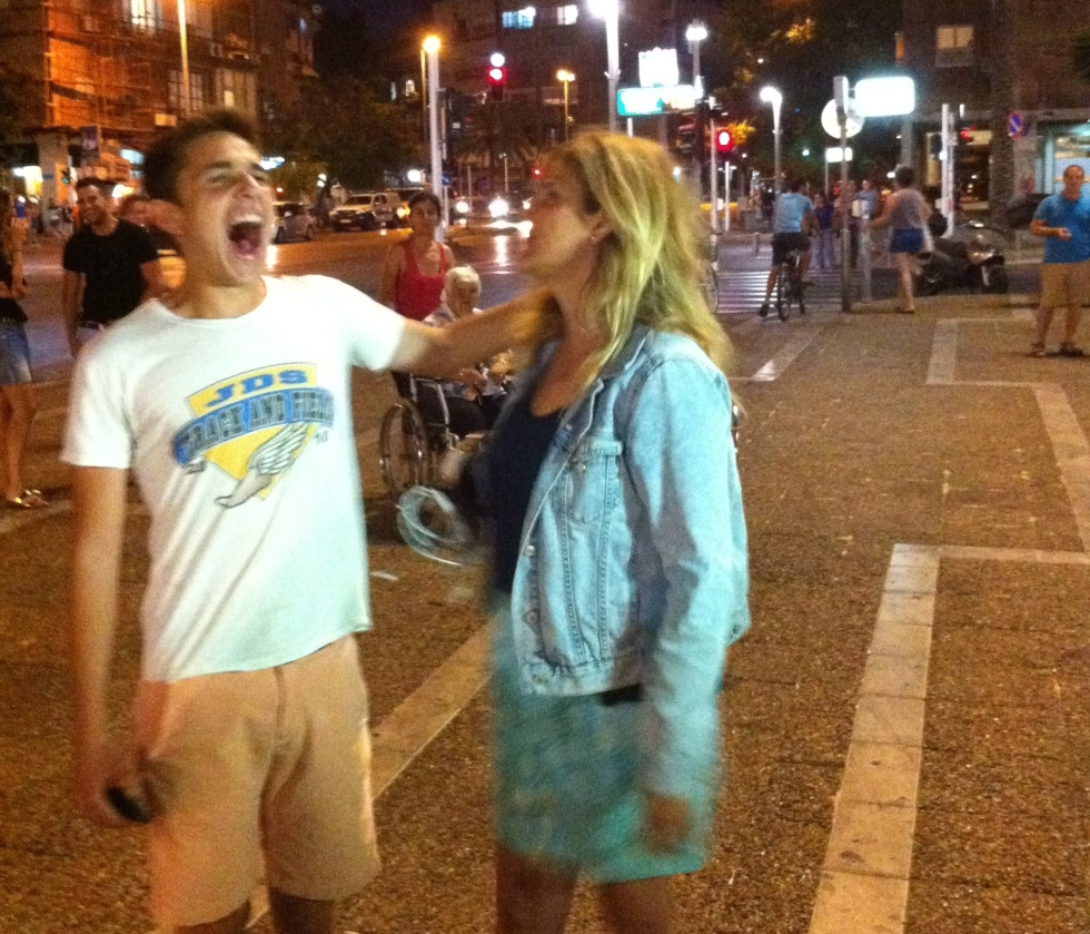 A young American boy and who I assumed was his mother scream obscenities at an anti-war protest in downtown Tel Aviv this summer