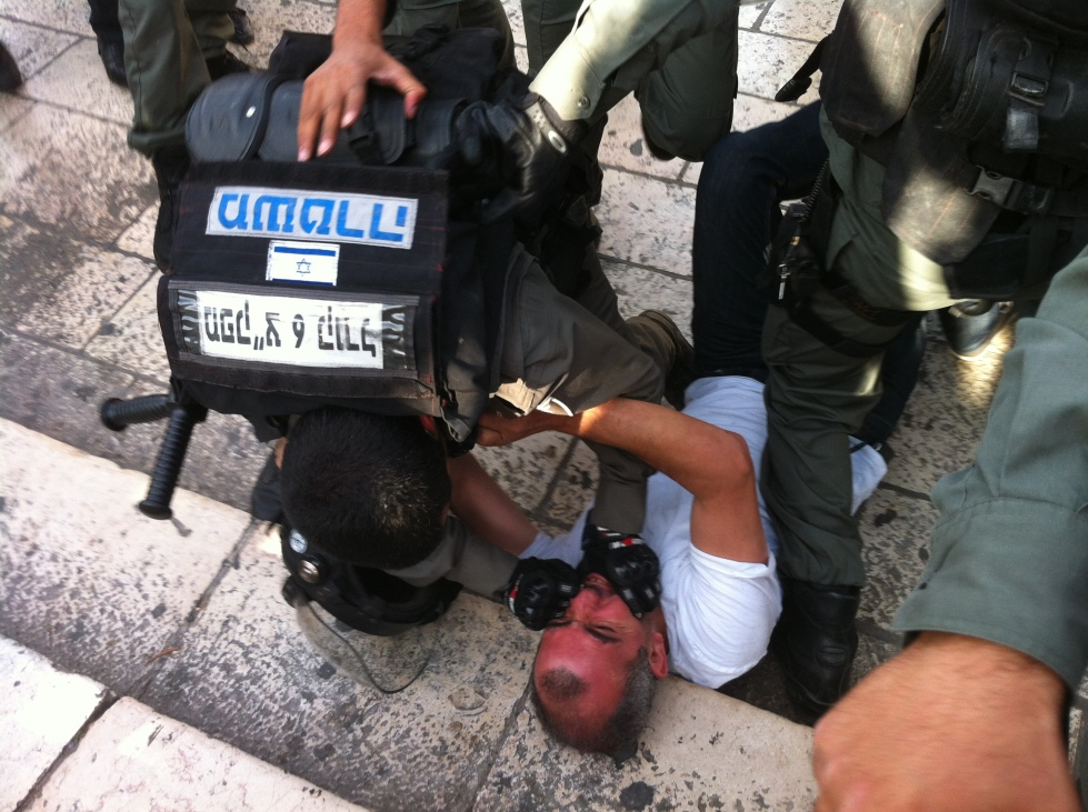 "Police arrest a Palestinian man during ""Jerusalem Day,"" 2014"