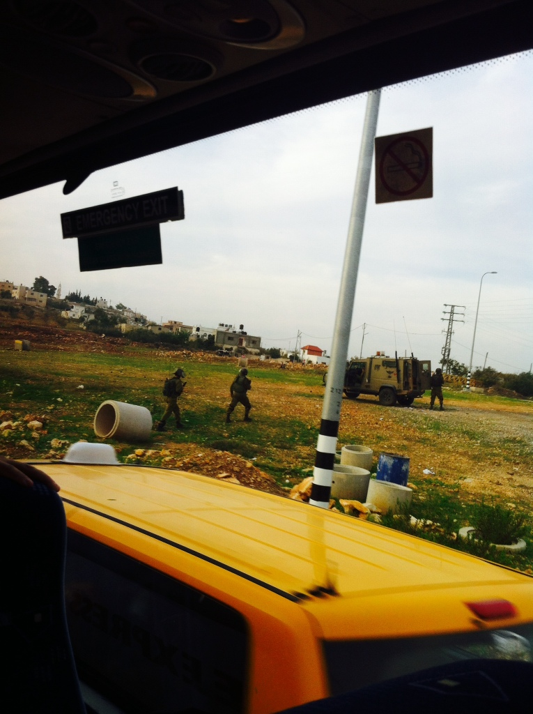 This photo is not from Ofer, where cameras are not allowed, but rather from later in the day, when we passed by a clashes between Israeli soldiers and stone throwing Palestinian youths near the village of Nabi Saleh