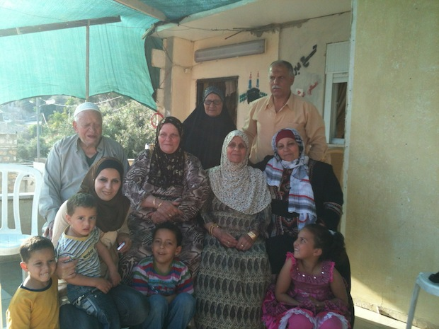 The Ruweidi family outside their home in Silwan, East Jerusalem, after hearing news of their victory in the District Court. May 9, 2012.