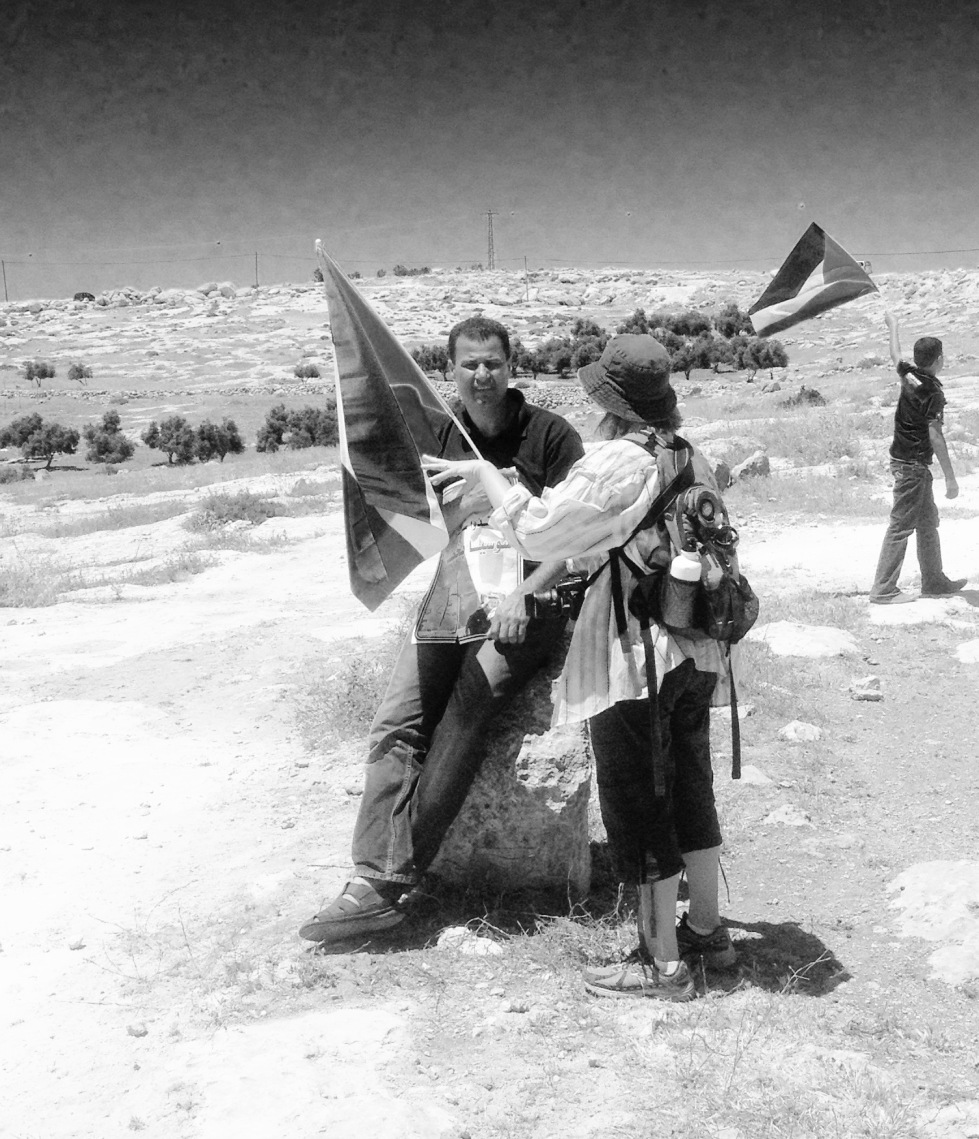 Among the marchers was Abdullah Abu Rahmeh, a well-knonw leader of the popular struggle in Bil'in (pictured talking with Emily)