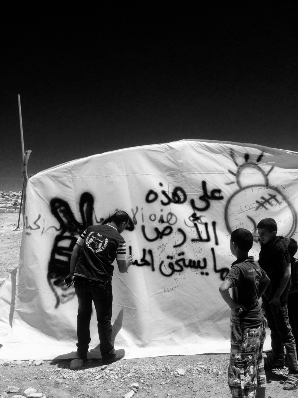 The first part of the action was renewing the messages on the tents, including quotes from Mahmoud Darwish