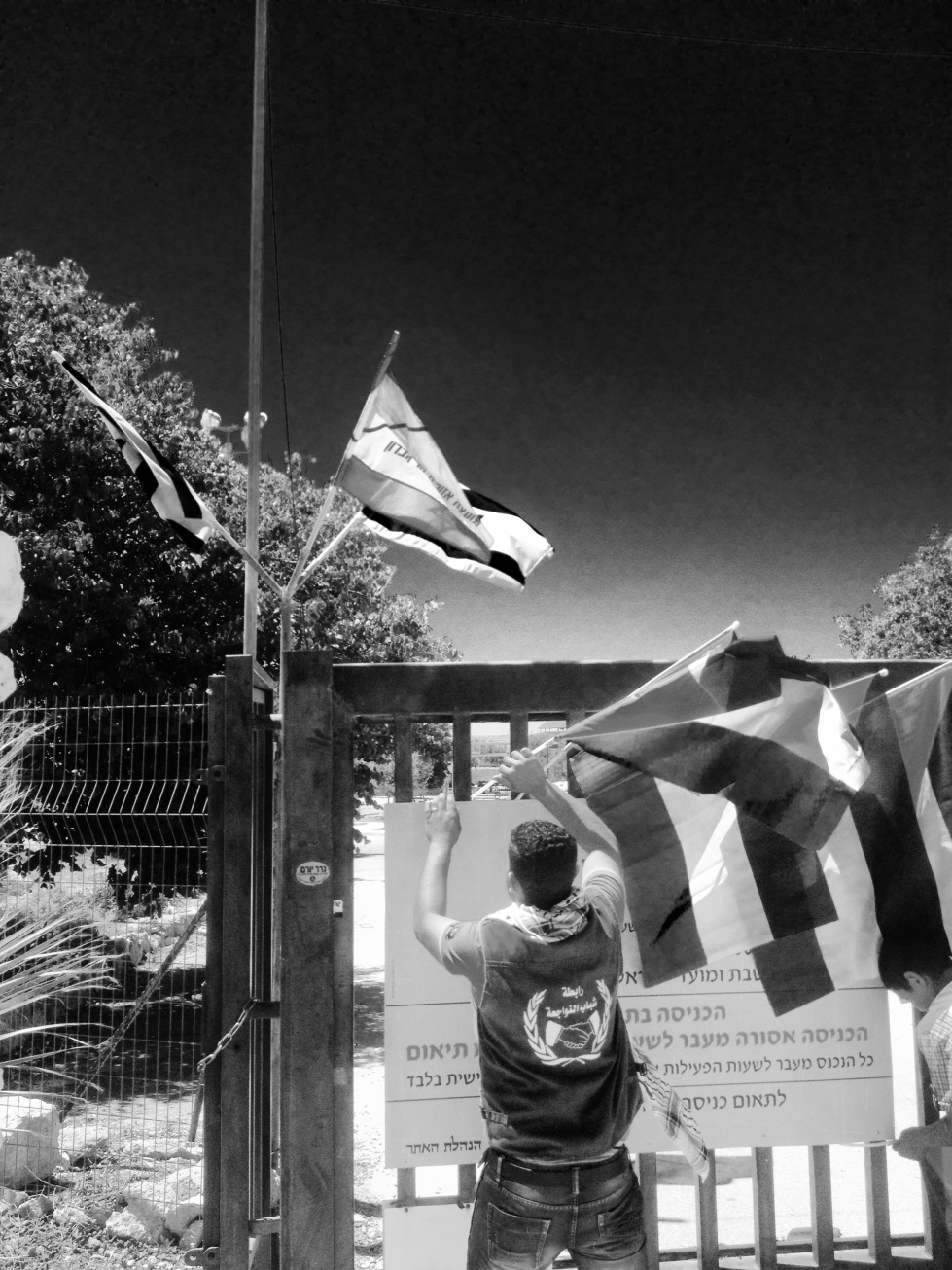 Meanwhile, marchers managed to hang Palestinian flags on the gated entrance to the their old village.