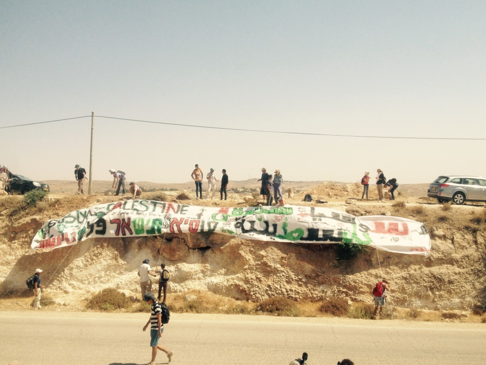 "As a final act of solidarity and defiance, residents of Susiya and supporters hung a huge banner that read: ""Susiya will remain Palestinian."""