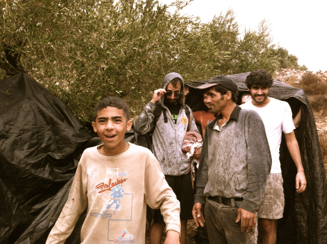 Palestinian farmers and Israeli volunteers stuck in the Fall near the village of Burin
